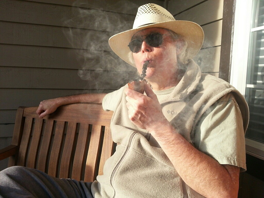 026_Robinson_with_pipe_on_porch_2015