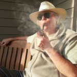 Robinson_on_porch_with_pipe