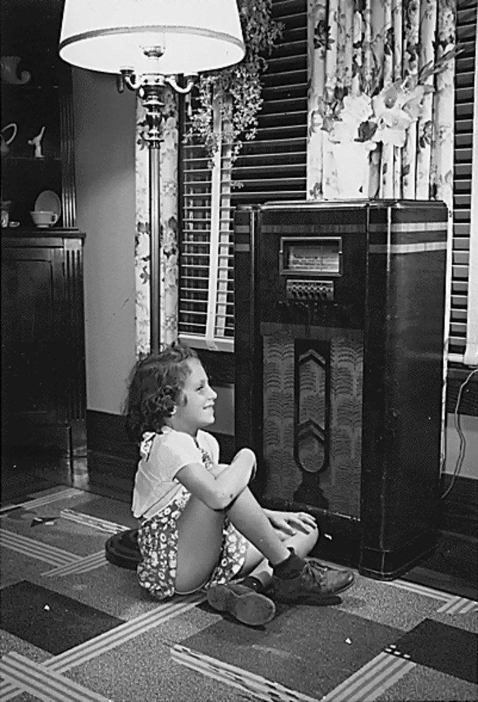 10 girl listening to radio public domain